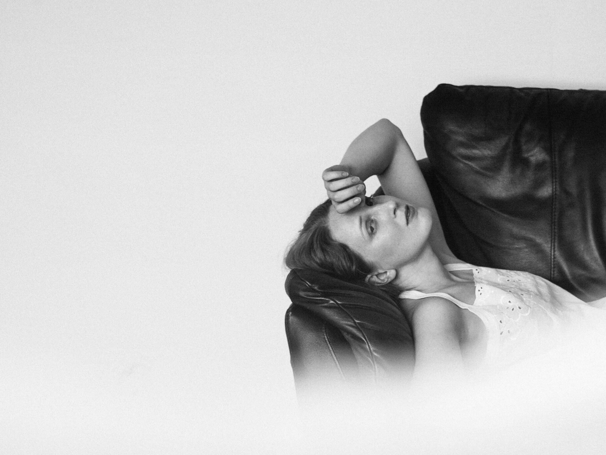 black and white minimalistic photo of the model on the couch